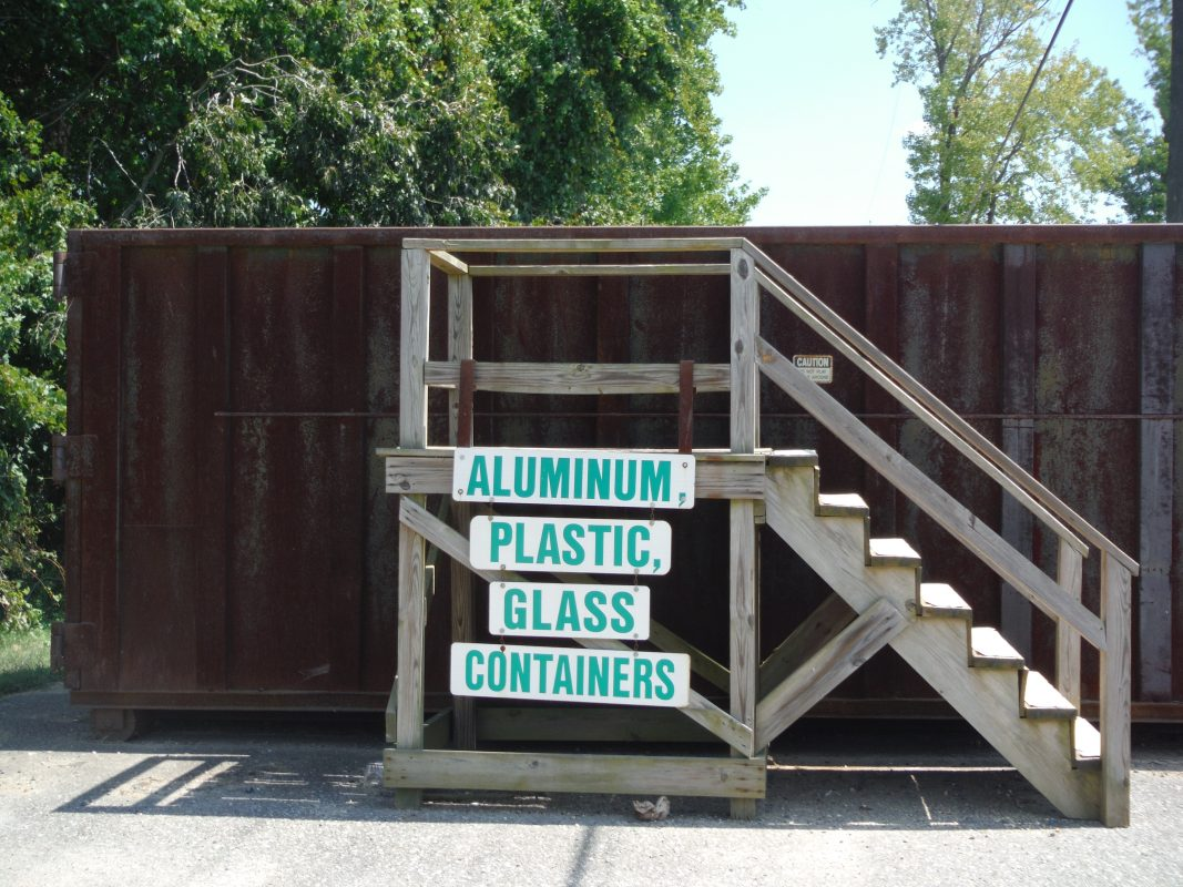 Aluminum, plastic, glass containers dumpster with wood stairs