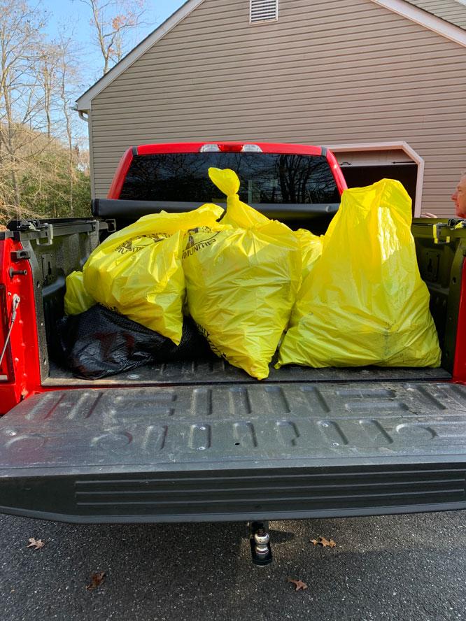 yellow trash bags in bag of pickup