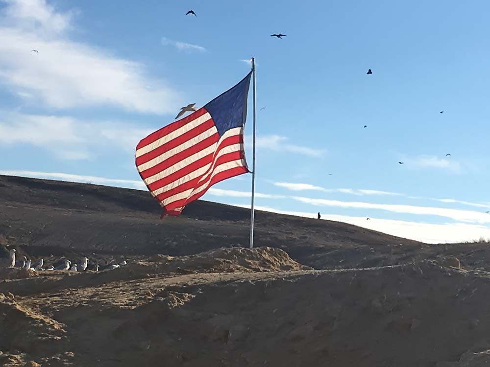US flag flying at the landfill