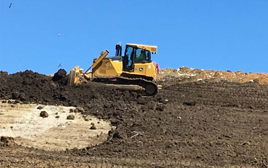 Tractor grading at the landfill